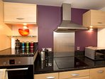 The separate kitchen is  ideal for larger groups, you can cook a meal whilst everyone else relaxes