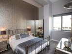 The gorgeous main bedroom has a king-size bed and en-suite bathroom