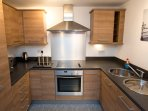 The kitchen has hob, oven, fridge-freezer and dishwasher plus all the utensils, plates etc