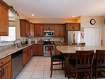 The beautiful kitchen with top rated appliances and well equipped cupboards.