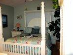 Master w/wrap around balcony/sliding door & poster Queen bed