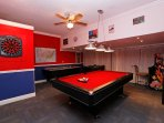 Wonderful game room with pool, air hockey, table foosball, darts and a game arcade machine