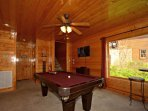 Downstairs you will find the Pool Table and Amazing Views and Access to Balcony with Hottub!