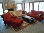Upper level family room has a vaulted ceiling and slate floors.