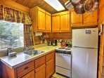 The fully equipped kitchen features a window that looks out onto the Tatoosh mountain range.