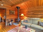 Curl up on the couch next to the energy-efficient wood stove.