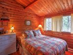 The bedroom features a plush deluxe queen-sized bed with down pillows.