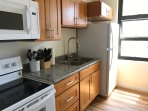 Newly remodeled kitchen- fridge, oven, stove, microwave, pots/pans, dishes and small appliances