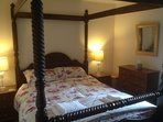 Bedroom with king size four poster bed.