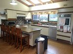 kitchen seats 5, induction cooktop, microwave, double wall oven, toaster, elec jug, dishwasher