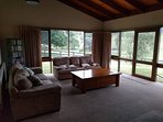 lounge room with great view of the property, TV, wood fire, seats 6