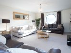The huge, sociable lounge/dining/kitchen space is ideal for large families.