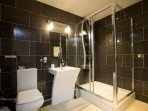 Lovely en-suite, designer bathroom, including a multi-jet shower cubicle