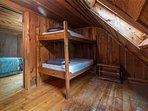 Bunk bed room with skylight