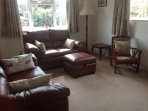 Comfortable living room with new leather furniture, flat screen TV, DVD etc.
