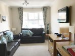 Lounge with wifi , TV,DVD player, games & books. Wifi and sofa-bed to sleep addtional guests