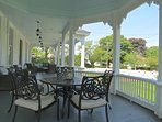 Grand, wrap-around porch provides shade with class.  Pour a glass of iced tea and enjoy.