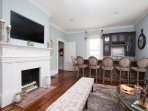 The Great Room has a flat screen TV, comfortable decor and an impressive seven seat wet bar