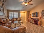 Sink into the leather couches and enjoy entertainment on the flat-screen TV.