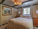 The master bedroom features a queen bed and flat screen cable TV.