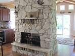 A stunning stone fireplace anchors the dining room, bar and den - with sliding doors to the deck.