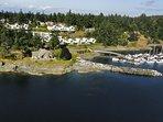 Private, oceanside estate in bay full of sea life