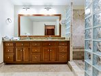 Ensuite 2nd master bathroom with double sinks and gorgeous glass block/ travertine shower