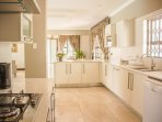 Kitchen fully equipped with all crockery, cutlery, dishwasher, washing machine and gas stove