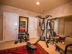 Fitness and workout room to stay in shape, free weight bars and dumbells.