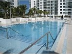 Full Access to the 2 over sized and heated swimming pools in the building.