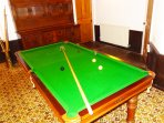 The dining table converts into a 6ft billiard and snooker table. There is a scoreboard on the wall.