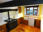 The solid oak kitchen was only added in 2003 – although the Aga oven and hob predates it.