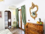 Master bed room (n. 1) with balcony offering great views on Mount Etna and the historic city center