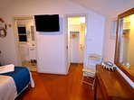 En-suite bathroom with all amenities and walk in wardrobe with bath robes included