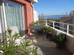 Sunny terrace with sunbeds and dining table - view of Etang