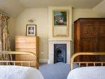 Lovely ornamental fireplace and mahogany wardrobe