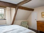 This room contains a super king size bed, and has lovely views through the stone mullion windows