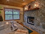 Elsa's Double-Sided Fireplace and Large Bedroom Jacuzzi