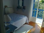 The double bedroom over looking the rear terrace with views over the sea to Kefalonia.