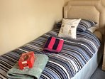 Twin bedroom with zip n link bed, Easter eggs provided for children at Easter.