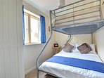 Bedroom with double bed and a single over