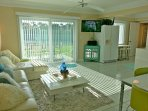 Open concept kitchen, living and dining room allows for unimpeded entertaining.