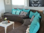 living room with lounge furniture couch fits 8 people