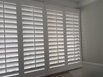 Plantation style shutters for privacy as well as customizable sunlight filtration.