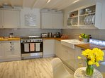Kitchen with a range cooker, dishwasher, fridge, freezer, nespresso coffee machine