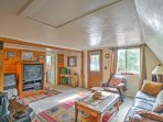 The cozy living room is complete with comfortable furnishings and a Dish TV.