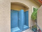 Utilize this outdoor shower to quickly rinse off.