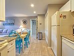 The kitchen is conveniently located right next to the dining table.