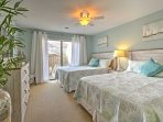The second bedroom includes 2 queen beds, a bathroom and a flat-screen cable TV.