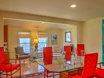 Gather around the glass dining table with seating for 6 to enjoy more formal meals.
